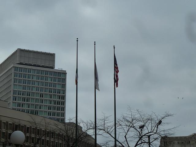Irish flag flying outside Boston city hall on the left