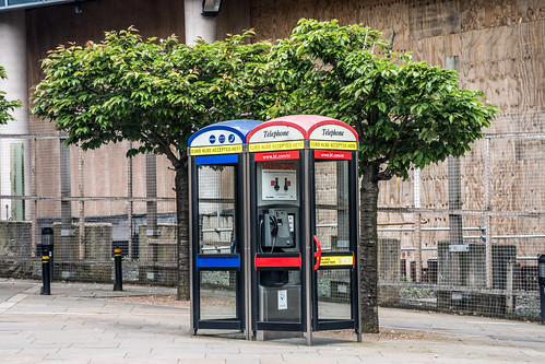 A telephone booth, telephone kiosk, telephone call box or telephone box is a small structure furnished with a payphone by infomatique