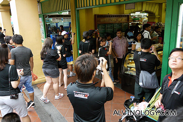 A group of Panasonic photographers invading a store in Little India