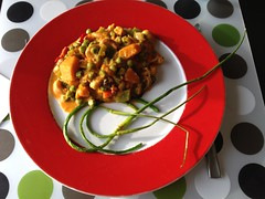 Pumpkin curry and baked garlic flower stems