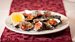 Rhys' Oysters- topped with diced tomato, red onion and basil