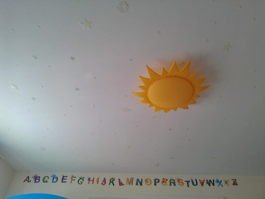 My bedroom ceiling with a sun lamp and glow in the dark stars