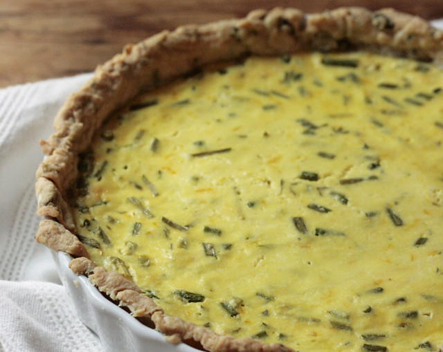 lemon ricotta tart with garlic scapes