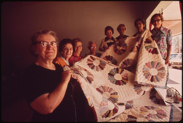 Members of the Golden Circle Senior Citizens Club of Fairmont holding quilt they made. The quilt was raffled off during the Fairmont centennial, May 1973