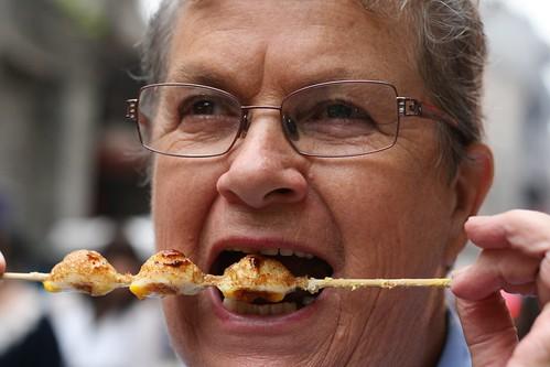Eating street food - quails eggs