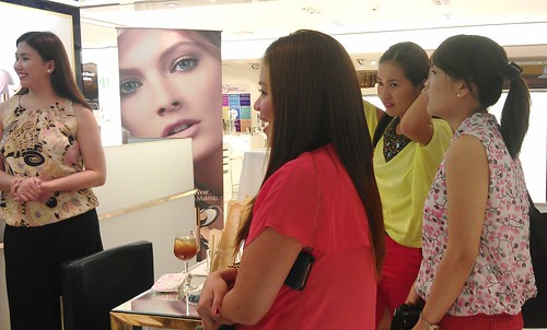 Liz of Estee Lauder with Shen, Angela and Nikki watching the demo intently