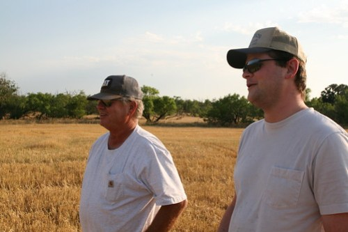 Mike and Ryan Campbell watch their crop being harvested