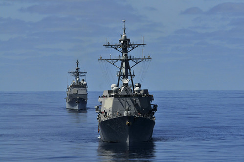 Ships are underway in formation before participating in a sea power demonstration. by Official U.S. Navy Imagery