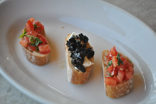 Bruschetta in varieties of tomato and black olives with Feta cheese and honey by the real Caffeamore