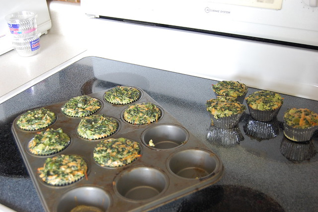 Muffin tin filled with crustless spinach quiche cups