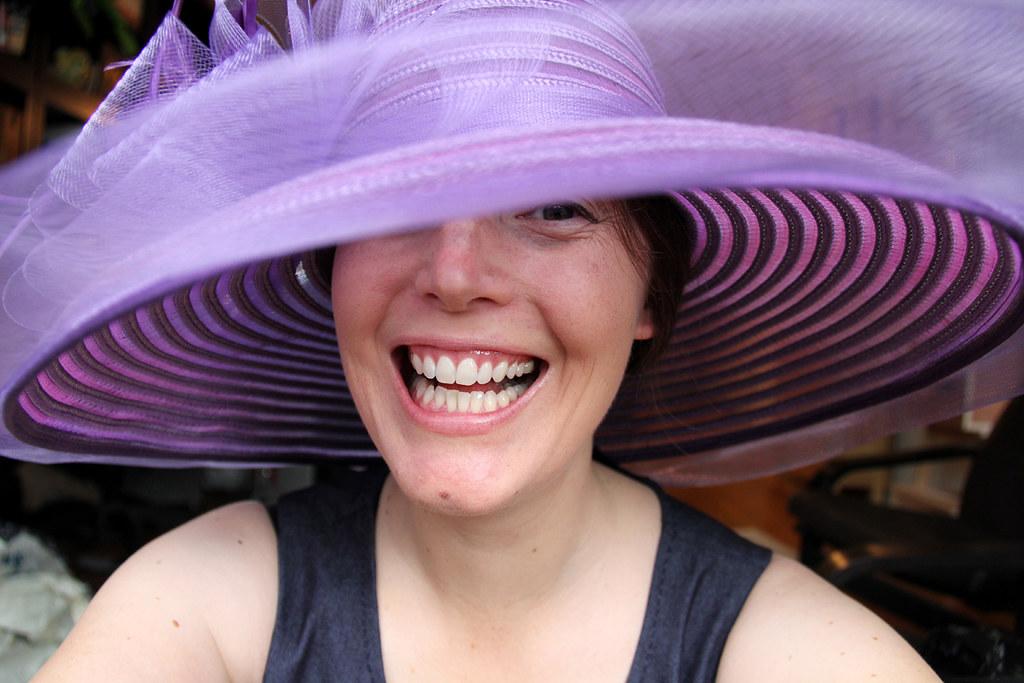 Fake laugh & purple hat.