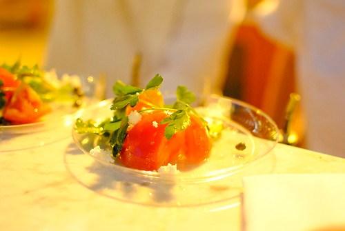 Estiatorio Milos line caught wild sea bass in sea salt crust, capers, parsley, lemon olive oil dressing; tomato salad, english cucumber, red onion, green peppers, olive oil, oregano, santorini capers, barrel aged feta cheese