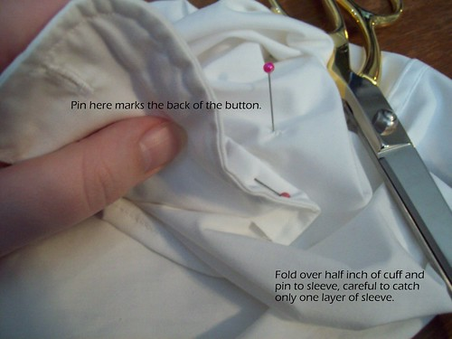 pin cuff to inside of sleeve near button