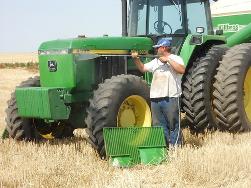 Greg washes out the radiator on the tractor