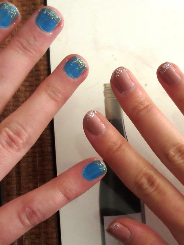 Glitter-tipped nails.