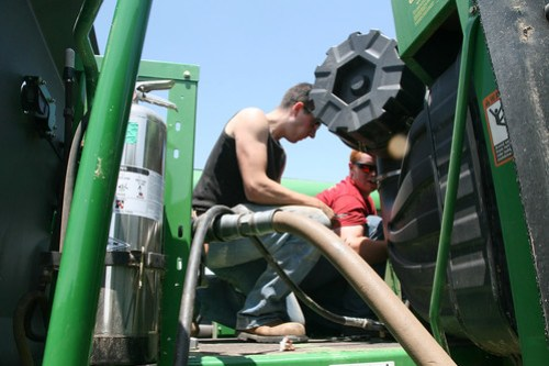 Dave and Callum fuel up the combine.