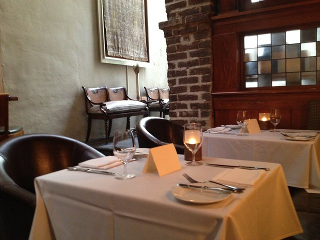 Dining tables opposite bar - McCrady's Restaurant