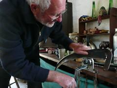 Peter Carmichael peening by machine, UK