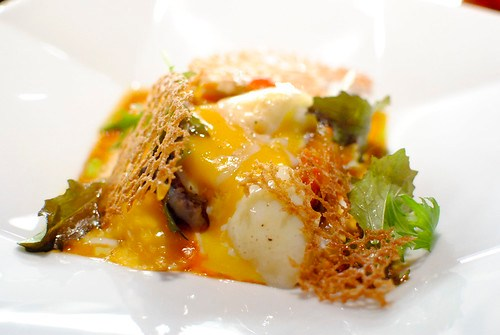 """l'oeuf soft boiled egg on a """"piperade"""" with parsley oil"""