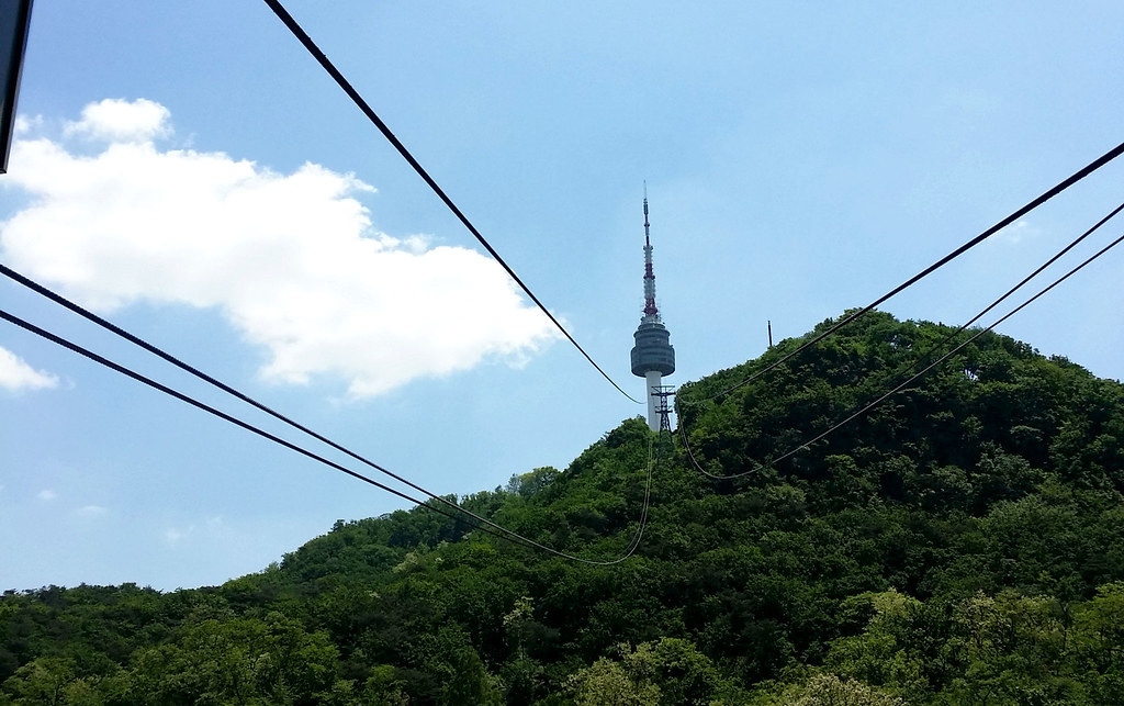 Namsan Tower peeking from the mountain as seen from the cable car