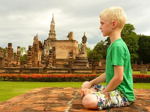 My son playing Buddha statue :)