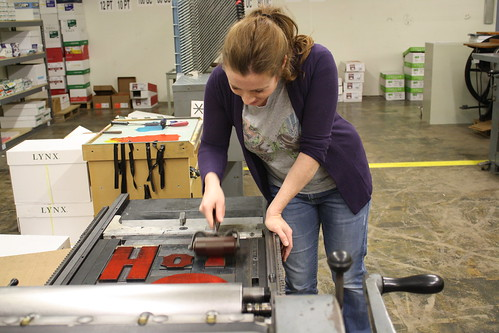 Amanda inking the press