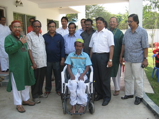 Delivery of a wheelchair by representatives from the Rotary Club of Motijheel in Bangladesh.