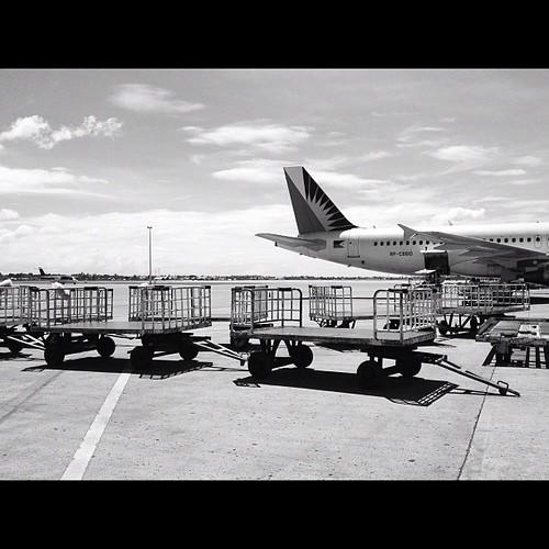 Empty carts. #iphone4s #blackandwhite #monochrome #awesomeshots #airport #airplane #pal #bnw #igersasia #igersworldwide #philippines #picoftheday #photographyeveryday #photooftheday #cebu