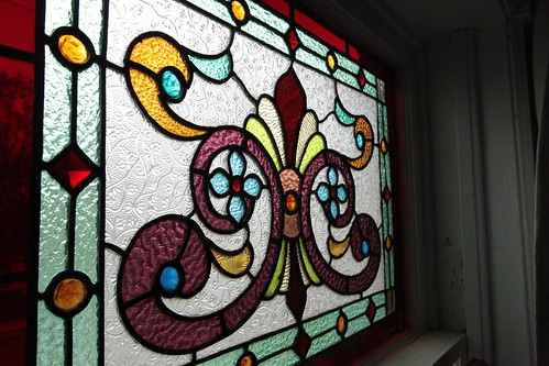 Stained glass window detail in bedrooms