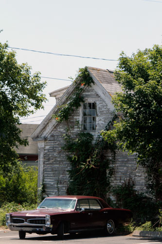 old car and building with vines