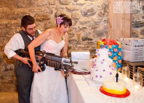 Cutting the cake with a retro lancer.