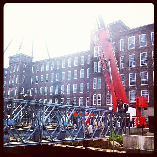 *Still* attaching the crane to the bridge...