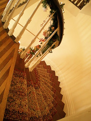 Stairs with garland down the hand rail