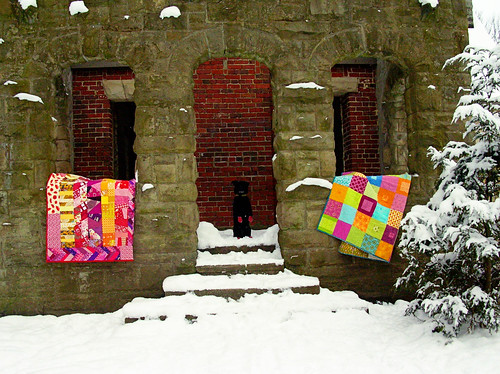 Simon posing with the quilts