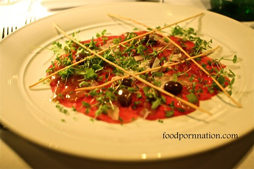 Free-Range Raw Beef Carpaccio with Truffled White Walnut Puree, Testun di Barolo Cheese, Rocket Cress, Wild Baby Olives and Handmade Rosemary Grissini @ Pendolino