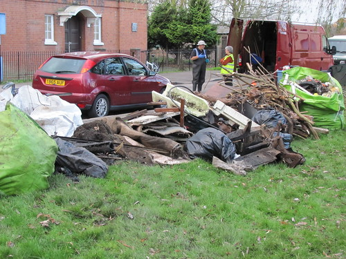 A really big pile of wood, concrete, carpet, and assorted other rubbish