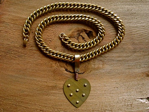 big brass heart on a big brass chain by denise carbonell