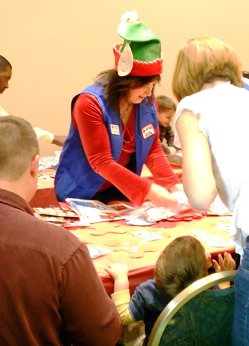 Florence teaches children how to make ornaments