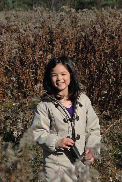 daughter posing in meadow