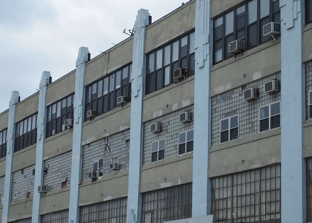 View of a factory facade in Sunnyside, Queens with some very ugly replacement windows