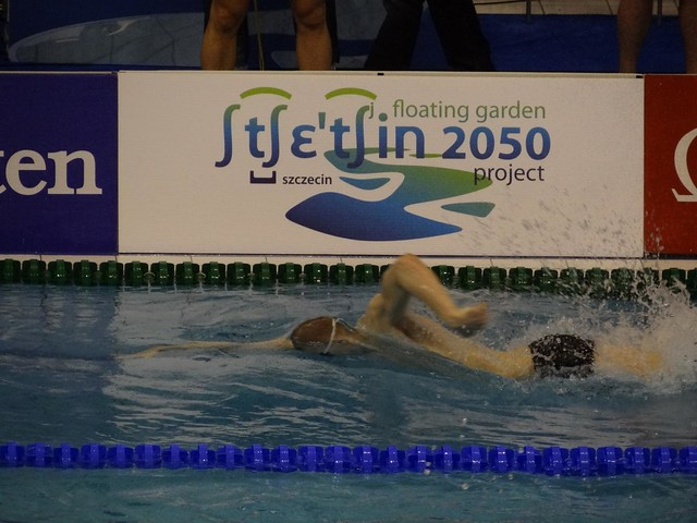 Pál racing past the Szczecin 2050 ad at Szczecin 2012