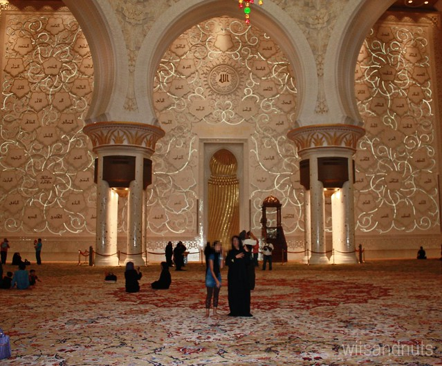 Qibla wall, with 24-carat gold used in mehrab (the niche found in the middle), Sheikh Zayed Grand Mosque, Abu Dhabi, UAE. The 99 names (qualities) of Allah are on the wall using traditional calligraphy.
