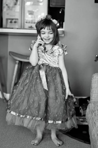Chatting it up in her play dress.