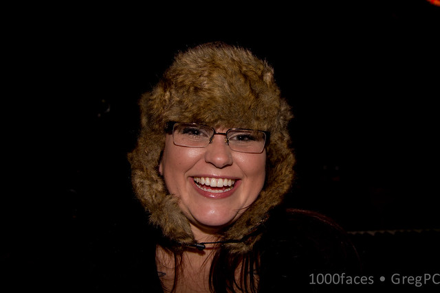 Face - smiling woman with a fur hat