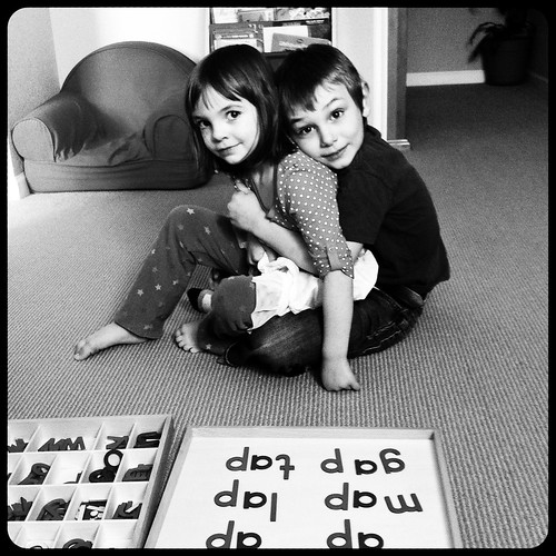 "Molly spelled ""lap"" then sat in Thomas' lap."