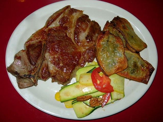 Pork Shoulder Steak, Pommes Maxim aux Herbes, Ribbon Zucchini Salad