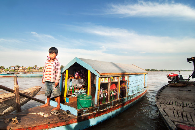 A boy selling soft drinks on boat