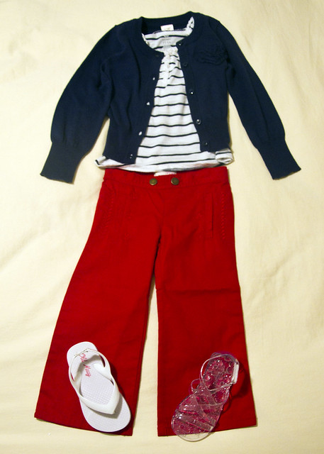 blue and white striped tank top, blue cardigan, red twill pants, white flip flops or clear gladiator sandals