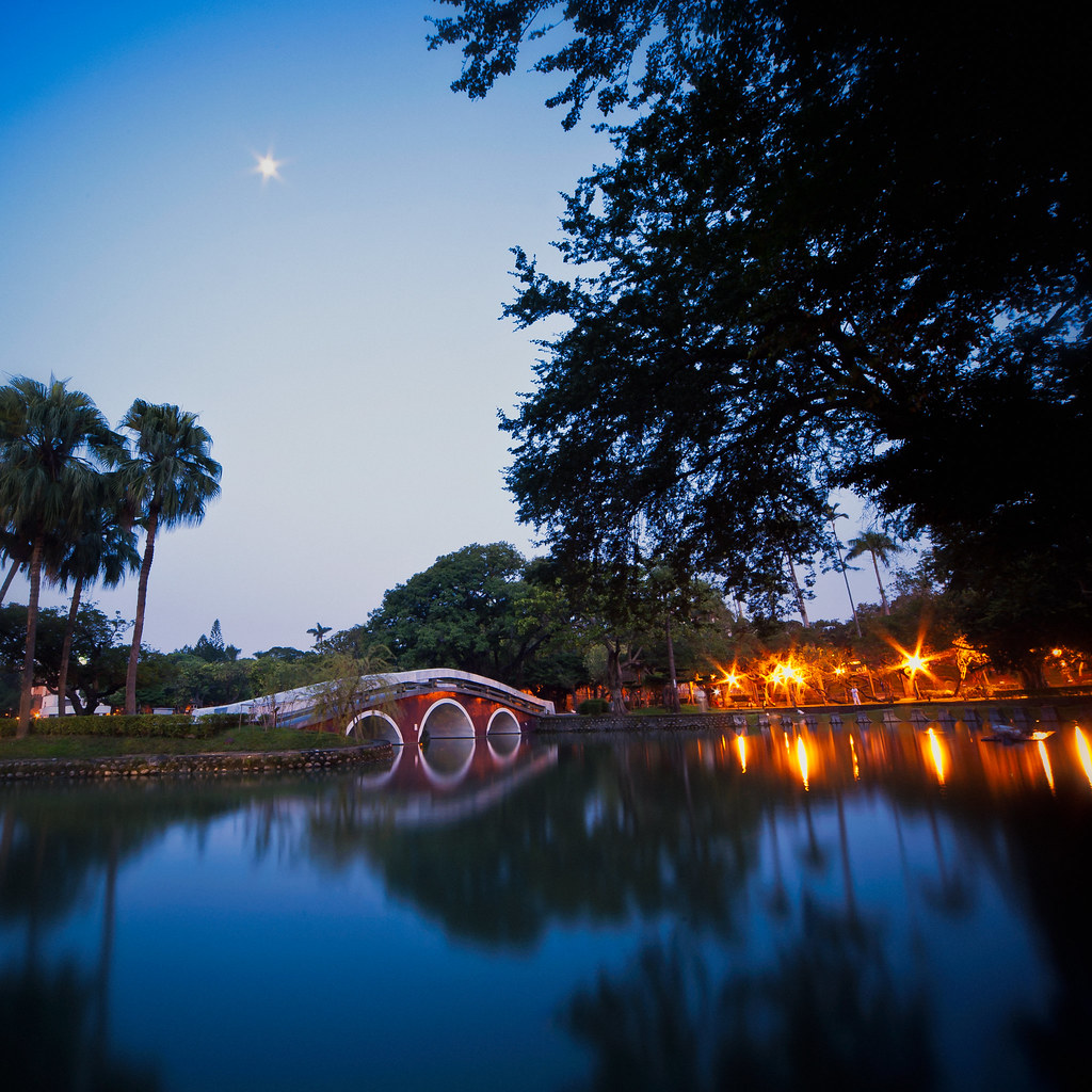 Moon over Taichung park pond just before the sunrise