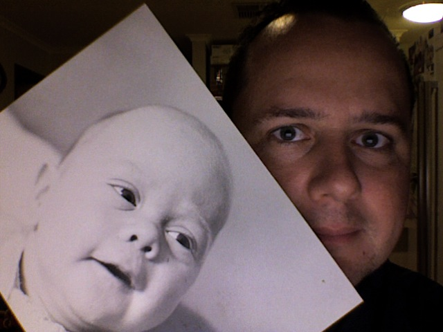 Take a photo of someone holding a photograph of themselves - Baby me & Current me